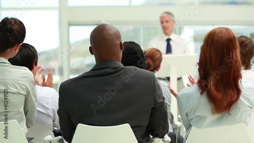 Business people listening to a speaker
