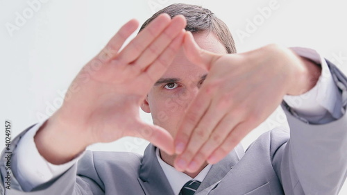 Serious brunette man making a hand gesture