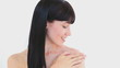 Smiling brunette woman massaging her shoulder