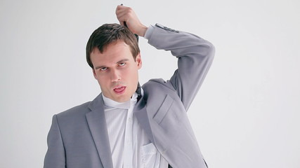 Frustrated businessman making a hanging gesture