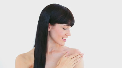Peaceful brunette woman massaging her shoulder