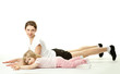 Happy mother doing sport exercises with her little daughter