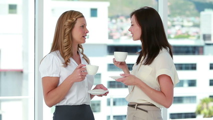 Businesswomen drinking coffee together