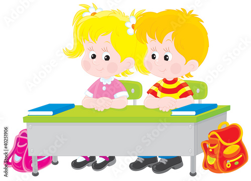 School children at a desk in a class