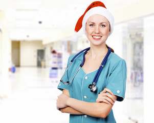 doctor wearing Santa hat in a hall of a hospital