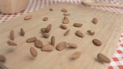Almonds being spread in super slow motion