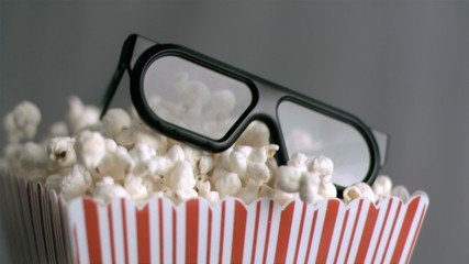 Popcorn box falling in super slow motion