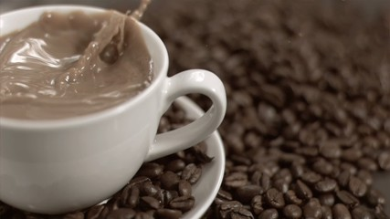 Sugar cube falling in super slow motion in white coffee