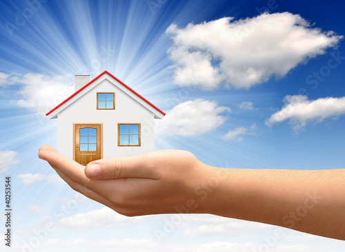 Little House on the hands against the blue sky