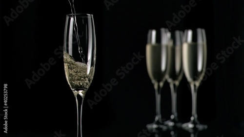 Champagne flowing in super slow motion in flute