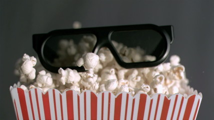 Popcorn box falling in super slow motion with 3D glasses