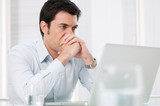 Pensive man at laptop