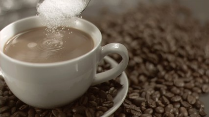 Spoon pouring sugar in super slow motion