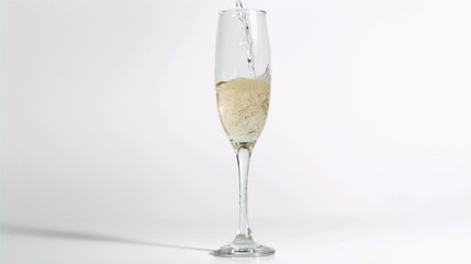 Glass filled in super slow motion with champagne