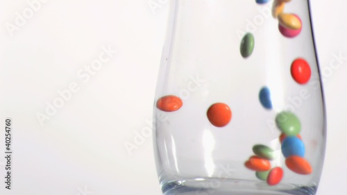 Close up of candies falling in super slow motion
