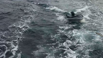 Dinghy engine towed. Motorboat in Andaman sea.