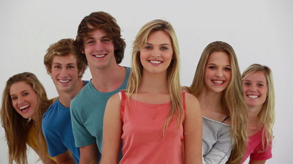 Young people appearing behind their friends