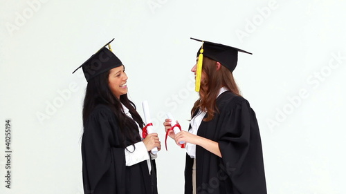 Friends hugging each other after their graduation