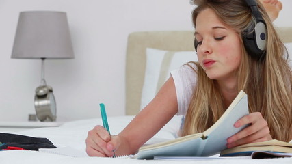 Serious young woman studying with notebooks