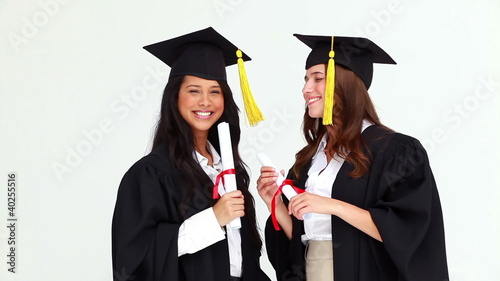 Happy graduated classmates talking to each other
