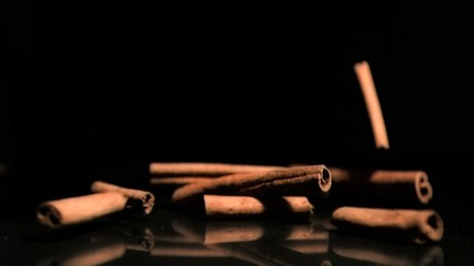 Cinnamon sticks falling in super slow motion