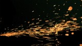 Sparks flowing in super slow motion on a surface