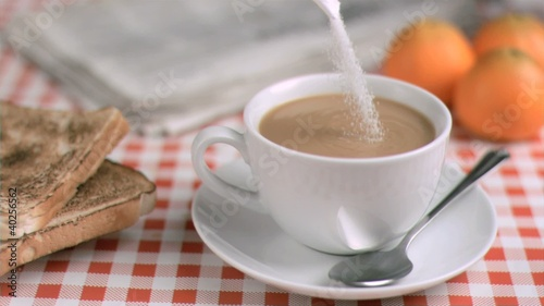 Sugar being poured in super slow motion