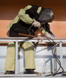 Welder working with a metal structure