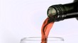 Bottle of red wine in super slow motion filling a glass