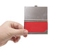 business card holder in a man's hand