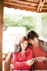 Young couple looking at mobile phone