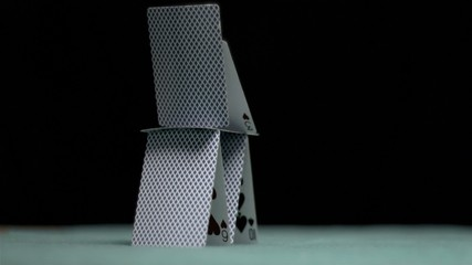 Pyramid of cards falling in super slow motion
