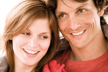 Young couple smiling, close-up