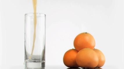 Orange juice splashing in super slow motion