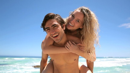 Blonde jumping on her boyfriend's back