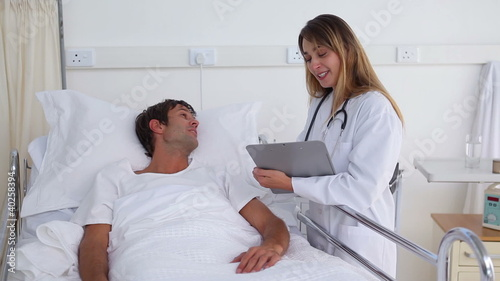Smiling doctor speaking to a patient