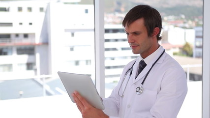 Doctor using a touchscreen tablet