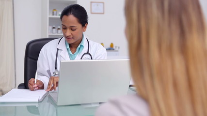 Woman consulting a general practitioner