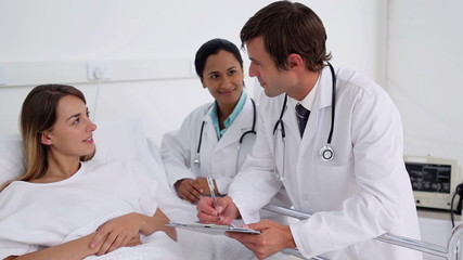 Doctors talking with a female patient