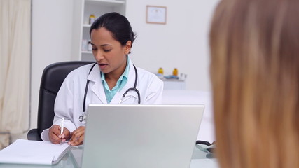 General practitioner asking question to a patient