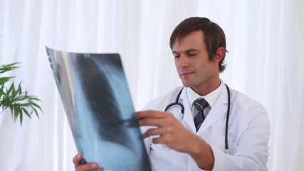Doctor looking a chest radiography