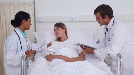 Two doctor talking to a patient
