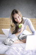Young woman holding green apple, smiling, portrait