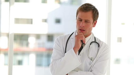 Thinking doctor pondering