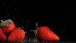 Nice strawberries in super slow motion being wet