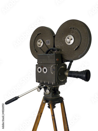 Old movie camera isolated on white