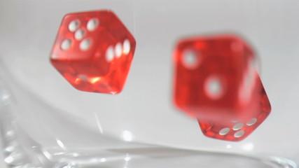Several dice in super slow motion falling