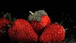 Red strawberries in super slow motion being wet