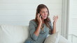 Woman laughing happily as she talks on a phone
