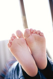 Bare feet of boy, close-up